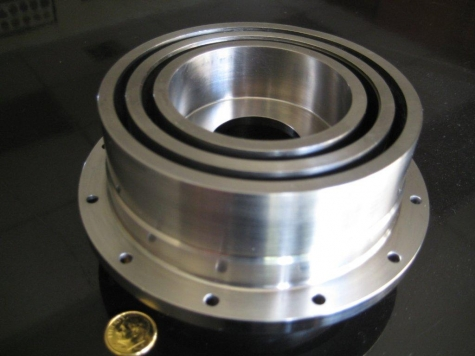 Titanium Isolator with .010 wall thickness between Grooves